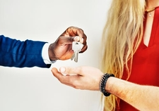 A close up picture of our customers receiving their keys for their new home in Providence, RI