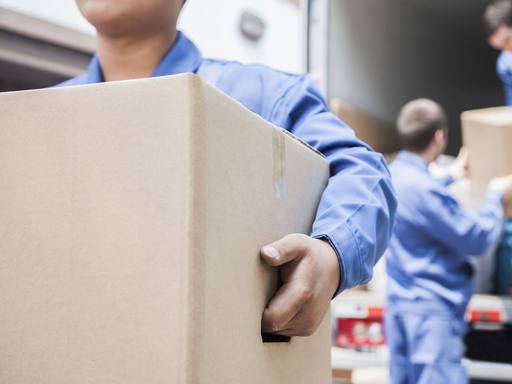 A close up of our employees unloading boxes from our truck in Providence, RI